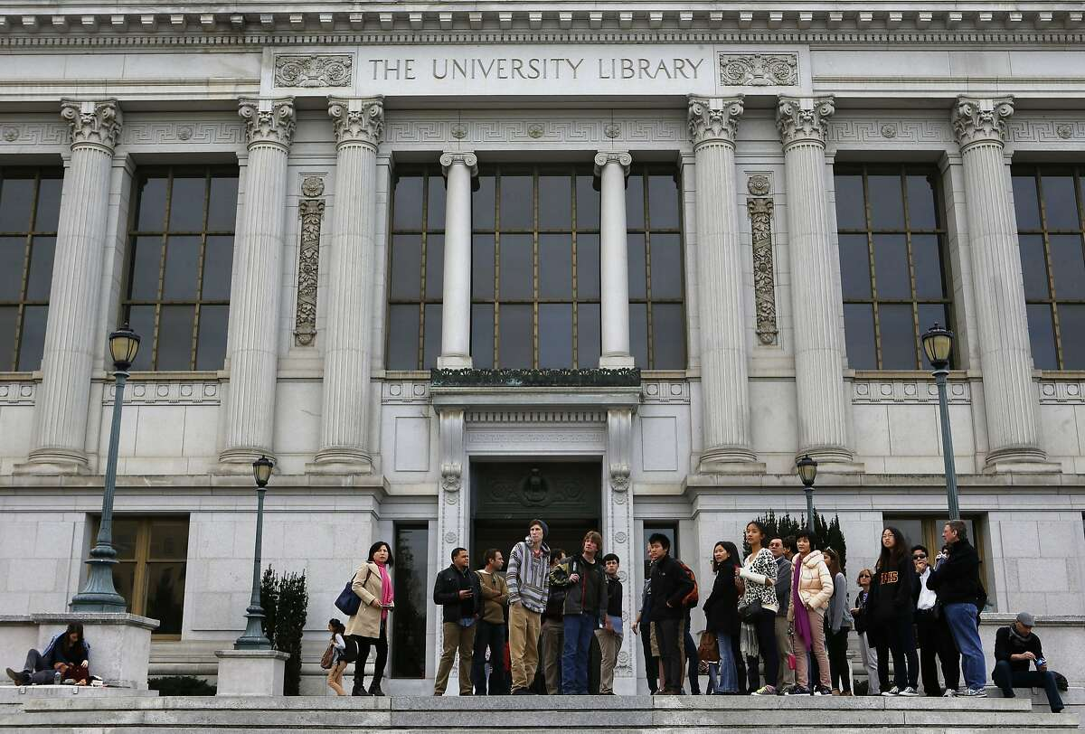 A tour group stops outside Doe Library on the UC Berkley campus in Berkeley, Ca., on Tuesday Jan. 28, 2014. The University of California Berkeley libraries are getting a cash infusion which will allow them to hire more librarians and staff.