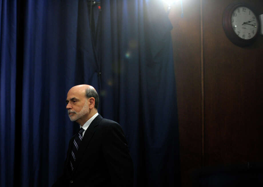 FILE - In this Wednesday, April 25, 2012, file photo, Federal Reserve Chairman Ben Bernanke arrives for a news conference at the Federal Reserve in Washington. The tumultuous Ben Bernanke era at the Federal Reserve moves toward its close with the final policy meeting of his eight-year tenure scheduled for the last week of January 2014.  (AP Photo/Susan Walsh, File) ORG XMIT: NYBZ111 Photo: Susan Walsh / AP