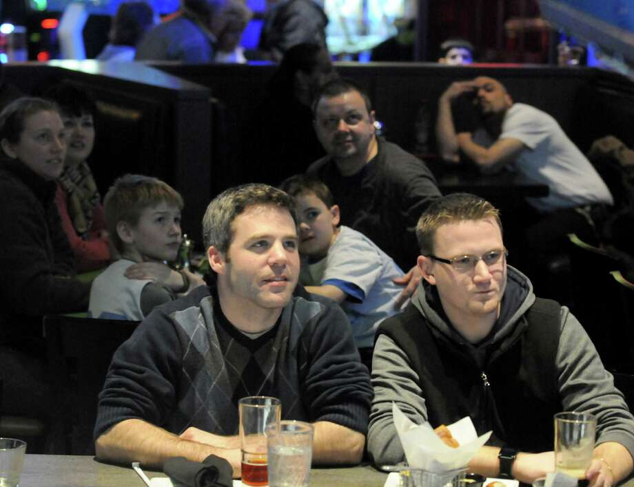 Eric Buist of Albany, left, and Michael Lynch of Guilderland watch sports at Dave & Buster's at Crossgates on Saturday Jan. 25, 2014 in Guilderland, N.Y. (Michael P. Farrell/Times Union) Photo: Michael P. Farrell / 00025504A