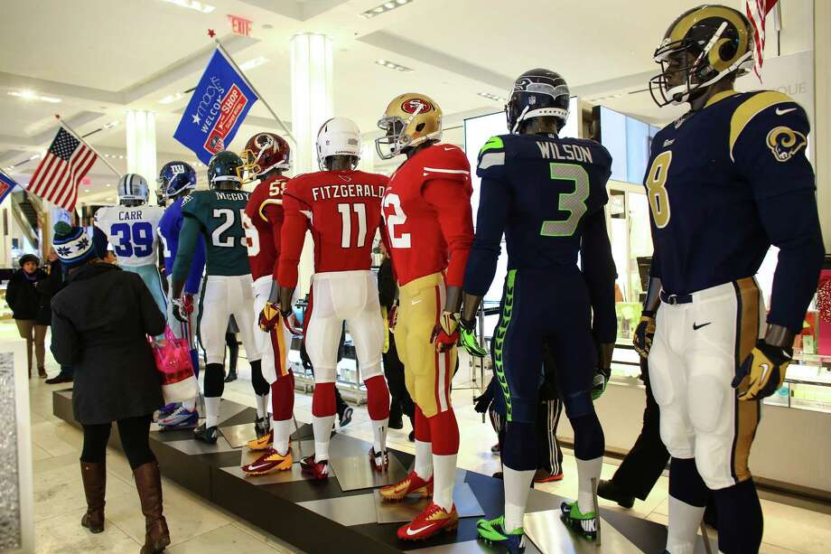 A uniform display is shown in Macy's during the Super Bowl Boulevard fan experience. Photo: JOSHUA TRUJILLO, SEATTLEPI.COM / SEATTLEPI.COM