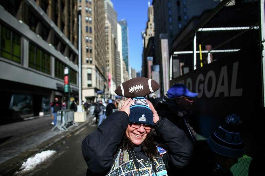 Cindy Aponze adjusts here homemade hat during the Super Bowl Boulevard fan experience. Photo: JOSHUA TRUJILLO, SEATTLEPI.COM / SEATTLEPI.COM