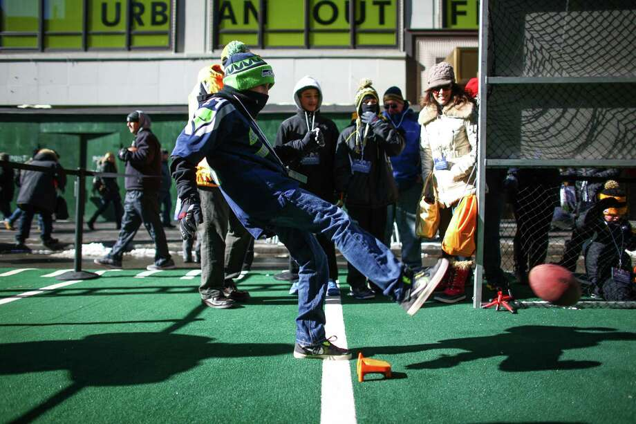 Seahawks fan Drew Doscher kicks a field goal during the Super Bowl Boulevard fan experience. Photo: JOSHUA TRUJILLO, SEATTLEPI.COM / SEATTLEPI.COM
