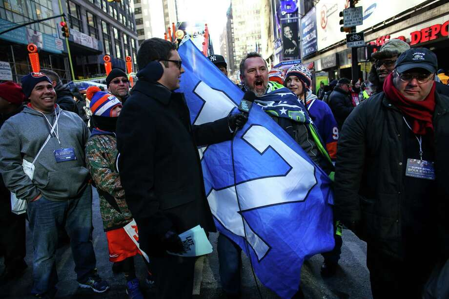 12th Man Les Johnson of Rochester, Wash. is interviewed by Arthur Meyer of the Jimmy Fallon show in Times Square. Photo: JOSHUA TRUJILLO, SEATTLEPI.COM / SEATTLEPI.COM