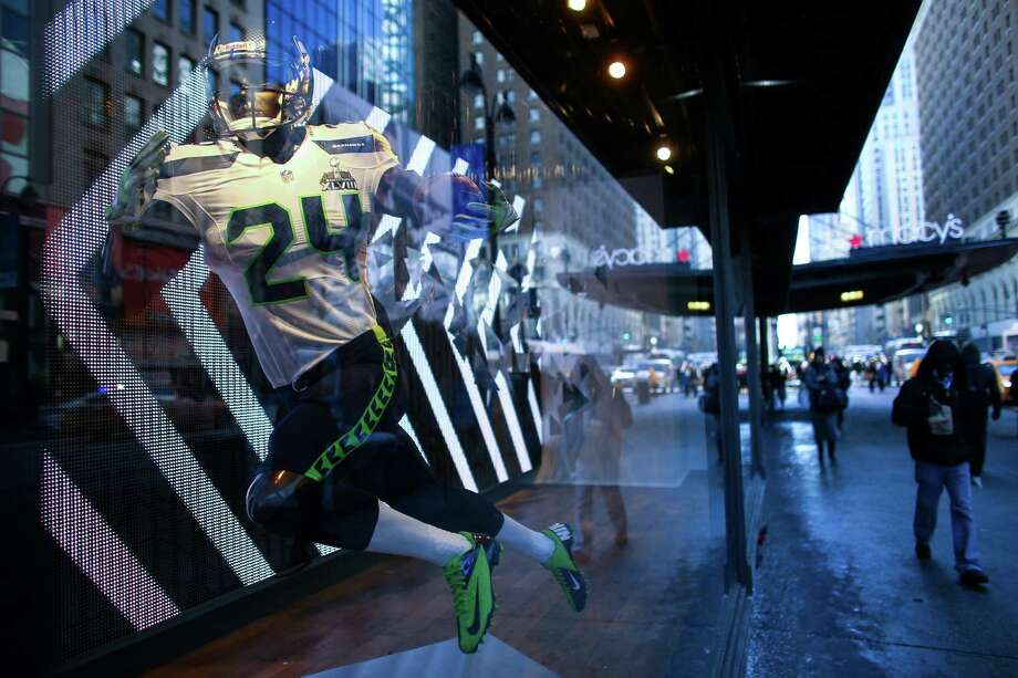 A Seahawks uniform is displayed in a window at Macy's during the Super Bowl Boulevard fan experience. Photo: JOSHUA TRUJILLO, SEATTLEPI.COM / SEATTLEPI.COM