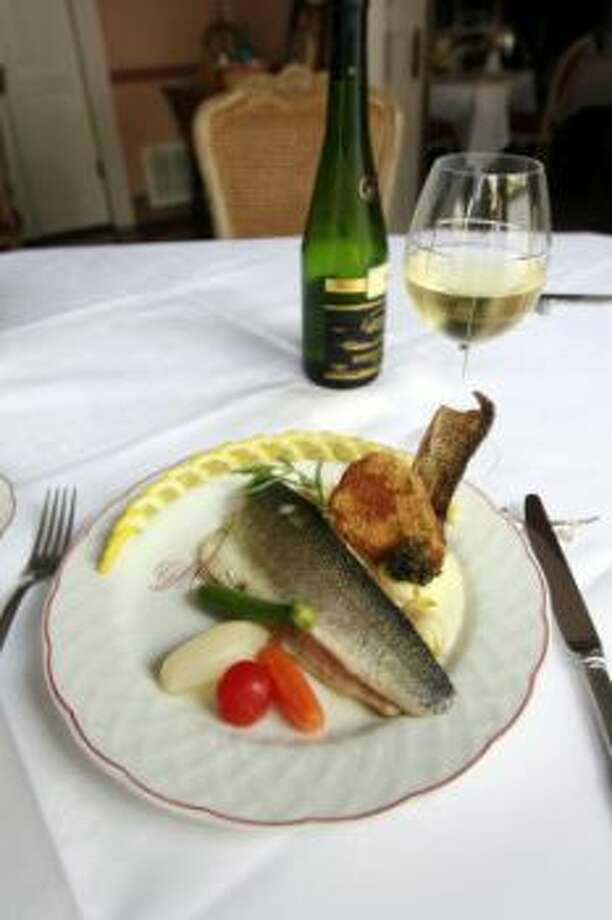 Loup de mer with garlic rosemary butter sauce at Chez Georges, 2006. Photo: James Nielsen/Chronicle