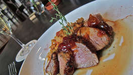 Pork tenderloin with white beans and chorizo, with sweet tomato compote, at Costa Brava Bistro.