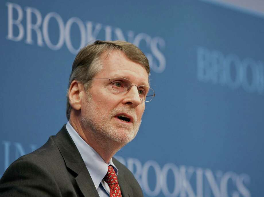 This handout photo provided by the Brookings Institution, taken Jan. 13, 2012, shows Gary Burtless of the Brookings Institution speaking in Washington. If the gap between haves and have-nots is the defining issue of President Barack Obama's second term, his health care overhaul was its first-term counterpart. Now it turns out the two are linked: new research shows that Obama's health care law will significantly boost the economic fortunes of people in the bottom fifth of the income ladder. Obama may be hard pressed to top his first-term accomplishment. (AP Photo/Ralph Alswang, Brooking Institution) Photo: Ralph Alswang, HO / Brookings Institution