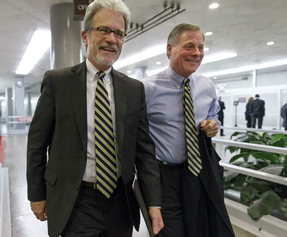 Sens. Tom Coburn, R-Okla. (left), and Sen. Richard Burr, R-N.C., have joined forces to sponsor the Patient CARE Act, which supposedly makes peace with the safety net while empowering individuals and rejecting bureaucratic centralization. Sen. Orrin Hatch, R-Utah, not shown, also is a sponsor. Photo: J. Scott Applewhite / Associated Press / AP