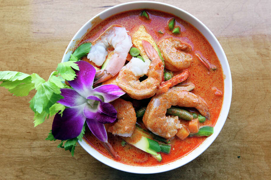 Saeb serves  red curry with shrimp  on January 29, 2014. Photo: TOM REEL