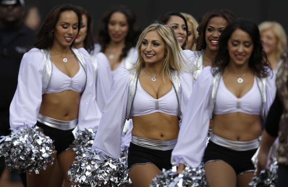 Oakland Raiders cheerleaders perform before an NFL preseason football game between the Oakland Raiders and the Dallas Cowboys in Oakland, Calif., Friday, Aug. 9, 2013. (AP Photo/Ben Margot) Photo: Ben Margot, Associated Press