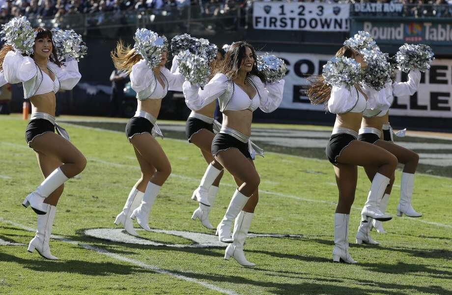 Oakland Raiders cheerleaders perform during the first half of an NFL football game between the Oakland Raiders and the Tennessee Titans in Oakland, Calif., Sunday, Nov. 24, 2013. (AP Photo/Ben Margot) Photo: Ben Margot, Associated Press