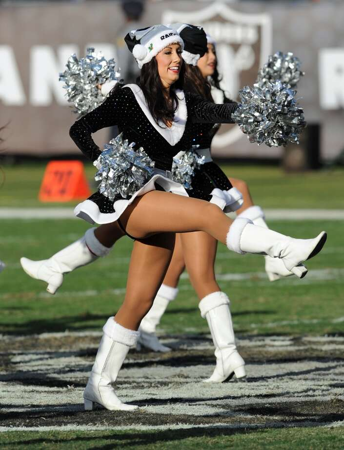 Raiders cheerleaders on the field during a game against the Kansas City Chiefs played at O.co Coliseum in Oakland, Calif. on Sunday, Dec. 15, 2013. (AP Photo/John Cordes) Photo: John Cordes, Associated Press
