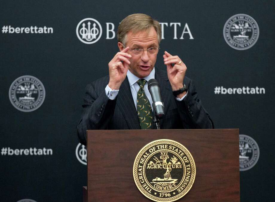 Tennessee Gov. Bill Haslam speaks during a ceremony at the state Capitol in Nashville, Tenn., on Wednesday, Jan. 29, 2014, to announce that firearms maker Beretta USA Corp. is building a new manufacturing a research facility in the state. The $45 million plant is expected to be completed this year and create 300 jobs. (AP Photo/Erik Schelzig) Photo: Erik Schelzig, STF / AP