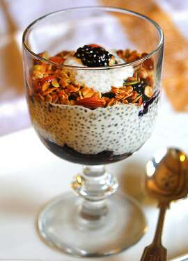 Ultimate Breakfast Parfait with chia seed pudding, granola and berries.