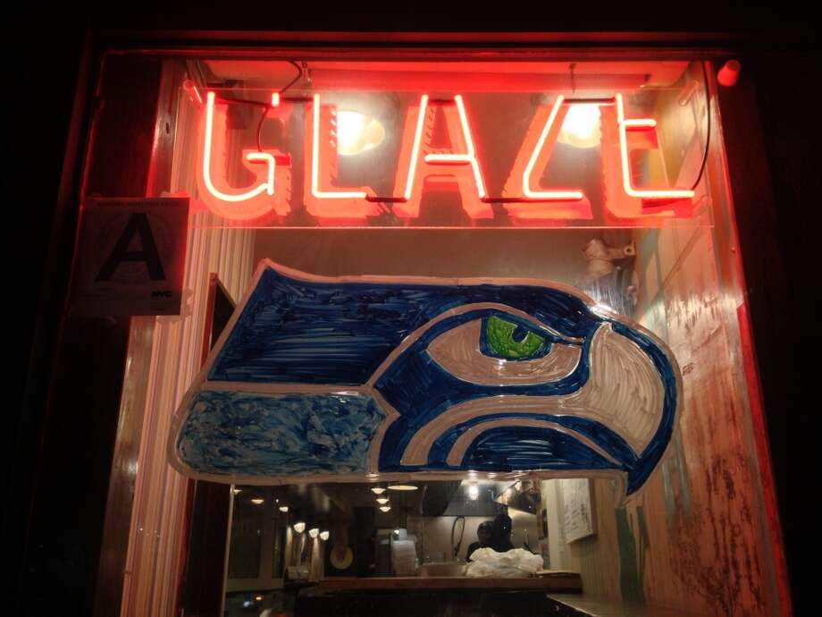 The window dressing at Glaze Teriyaki Grill in Manhattan leaves no doubt which team the business supports in Super Bowl XLVIII. (Photo by Chris Preovolos, Hearst Newspapers) Photo: Chris Preovolos, Hearst Newspapers