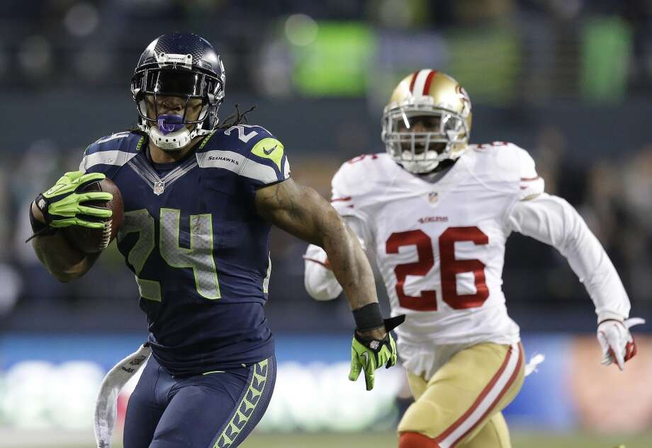 """Running backLynch's punishing running style and """"Beast Mode"""" persona gives the Hawks' offense an identity. That's especially true in the playoffs, where Lynch has racked up 560 yards and six touchdowns – including five of 15 yards or longer -- in six career appearances for Seattle.Former first-round pick Knowshon Moreno finally broke out in his fifth season, rushing for over 1,000 yards and 10 touchdowns for the first time in his career. He's also a threat to catch the ball out of the backfield, snagging 60 receptions for 548 yards and three touchdowns this year.Advantage: Seahawks Photo: Elaine Thompson, ASSOCIATED PRESS"""