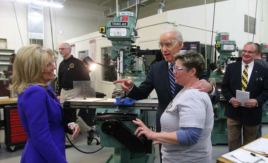 Vice President Joe Biden and his wife Dr. Jill Biden, left, visit with Monroe Community College student Robin Angevine-Funderburk during a tour of the precision machining lab, Wednesday, Jan. 29, 2014 in Rochester, N.Y. Recalling his days as an upstate New York college student, Biden says it seemed back then that companies like Kodak, Bausch and Lomb and Xerox would go strong forever. But at a community college campus Wednesday, he said times and jobs have changed, and pushed for educational programs that train students for today's higher tech jobs. (AP Photo/Democrat & Chronicle, Jamie Germano) ORG XMIT: NYROD102 Photo: Jamie Germano / Democrat & Chronicle