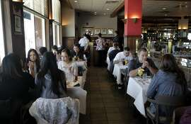 Diners enjoy the lunch service at Delancey Street Restaurant in San Francisco, Calif. on Saturday, Jan. 25, 2014.