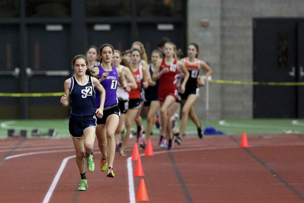Staples High School's Hannah DeBalsi during Wednesday evening 1600 meter heat at FCIAC Track Championships held at the Floyd Litttle Athletic Center in New Haven.