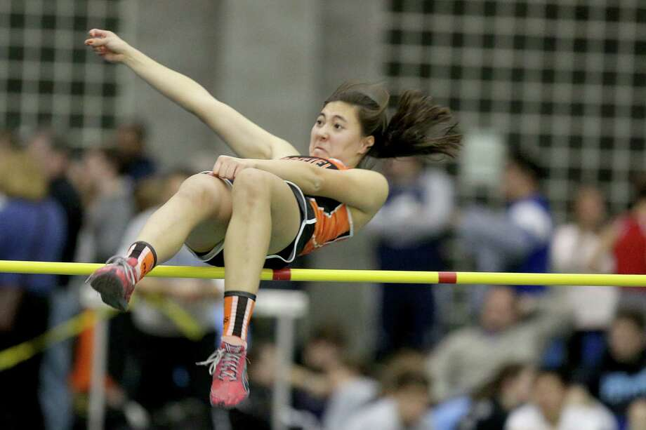 Ridgefield High School's Sofie Sogaard clears the bar during Wednesday evening High Jump event at the FCIAC Track Championships held at the Floyd Litttle Athletic Center in New Haven. Photo: Mike Ross / Mike Ross Connecticut Post freelance -www.mikerossphoto.com