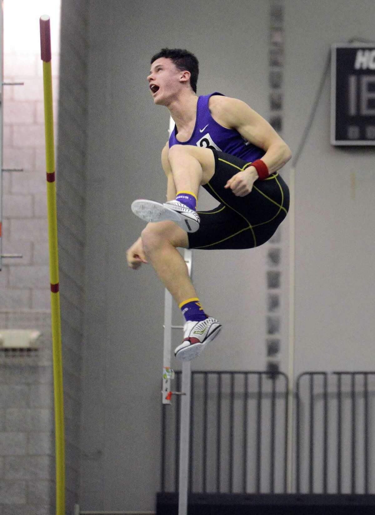 Westhill's Chris Rough competes in the pole vault event during the FCIAC Indoor Track Championships Wednesday, Jan. 29, 2014, at the Floyd Little Athletic Center in New Haven, Conn. Rough was the FCIAC boys pole vault champion at 14 feet.