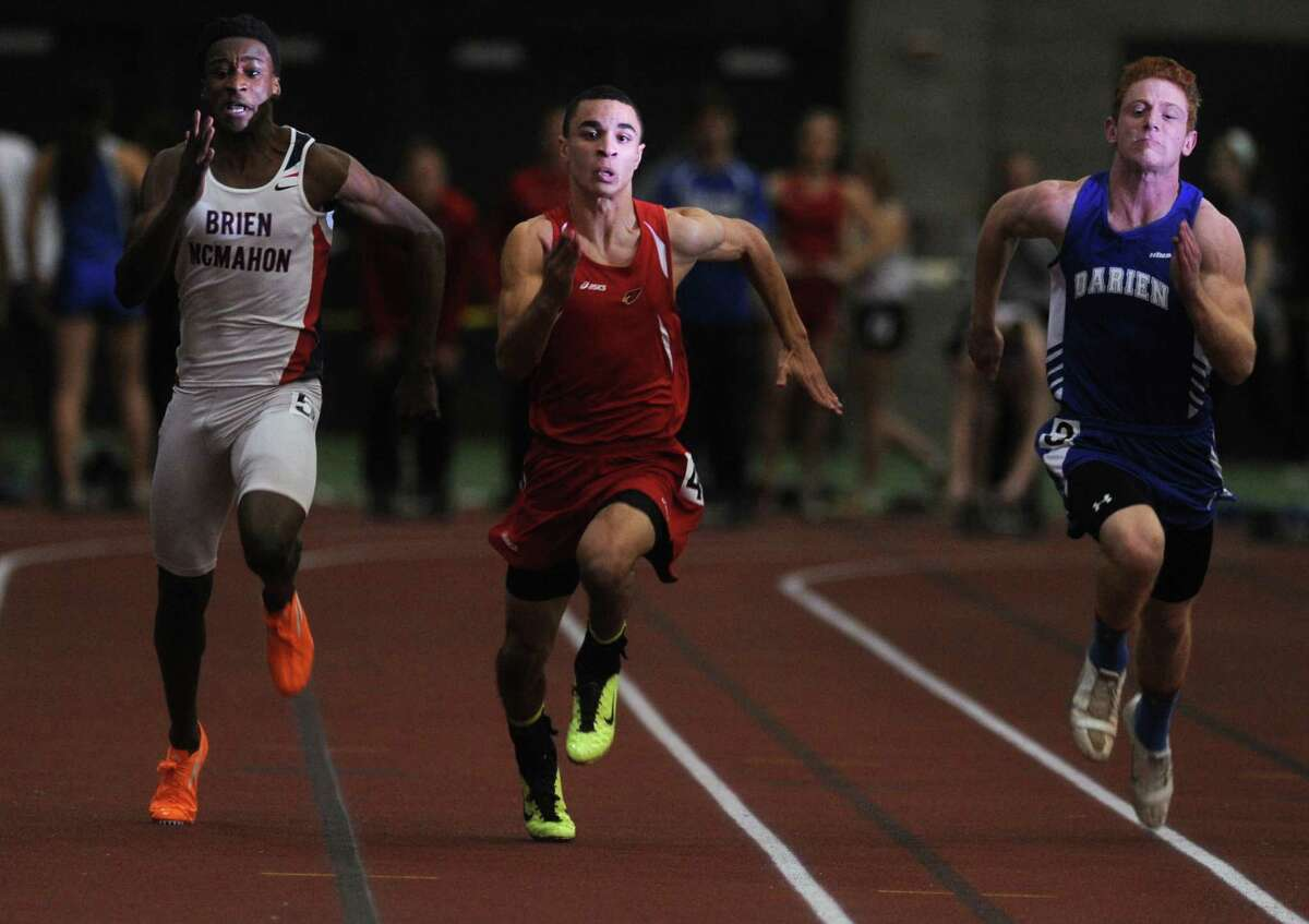 Greenwich's Austin Longi, center, competes in the 55 meter dash during the FCIAC Indoor Track Championships Wednesday, Jan. 29, 2014, at the Floyd Little Athletic Center in New Haven, Conn. Brien McMahon's Shnyden Pierre and Darien's Nicholas Lombardo compete also.