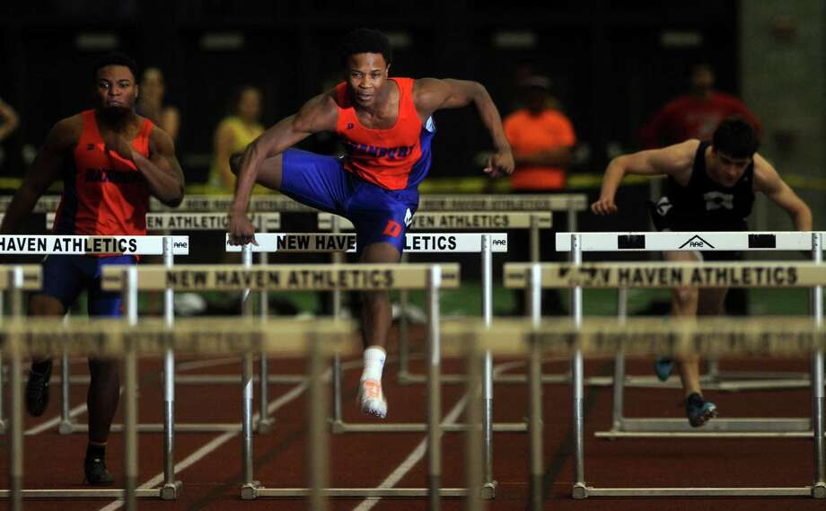 Danbury's Akim Moffett competes in the 55 meter hurdles during the FCIAC Indoor Track Championships Wednesday, Jan. 29, 2014, at the Floyd Little Athletic Center in New Haven, Conn. Photo: Autumn Driscoll / Connecticut Post