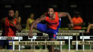 Danbury's Akim Moffett competes in the 55 meter hurdles during the FCIAC Indoor Track Championships Wednesday, Jan. 29, 2014, at the Floyd Little Athletic Center in New Haven, Conn.