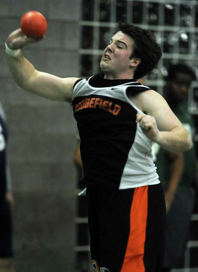 Ridgefield's Lucas Goff competes in the shot put event during the FCIAC Indoor Track Championships Wednesday, Jan. 29, 2014, at the Floyd Little Athletic Center in New Haven, Conn. Photo: Autumn Driscoll / Connecticut Post