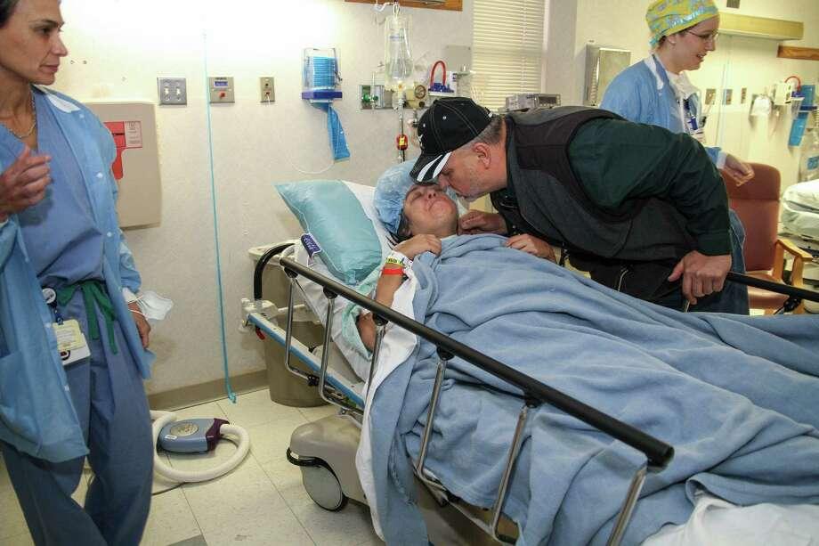 Rene Yanez, comforting his daughter Rachel Villarreal before she is taken in to surgery. Alma E. Hernandez / For the San Antonio Express News