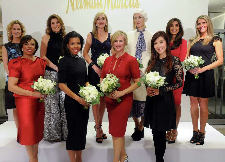 The Houston Chronicle's Best Dressed honorees pose for a photo at the  Best Dressed Announcement Party at Neiman Marcus Wednesday Jan 29, 2014.  From left: Courtney Hill Fertitta, Phyllis Williams, Estela Cockrell,  Claire Cormier Thielke, Jana Arnoldy, Vanessa Sendukas, Tatiana Massey,  Mandy Kao, Divya Brown and Gina Bhatia. (Dave Rossman photo) Photo: Dave Rossman, For The Houston Chronicle / © 2013 Dave Rossman