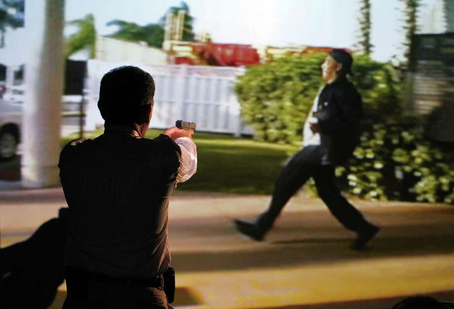 The shooting simulator that is part of grand jury orientation taints jurors, says a legal challenge by an oil executive who was arrested at the rodeo last year. Photo: Mayra Beltran, Staff / © 2013 Houston Chronicle