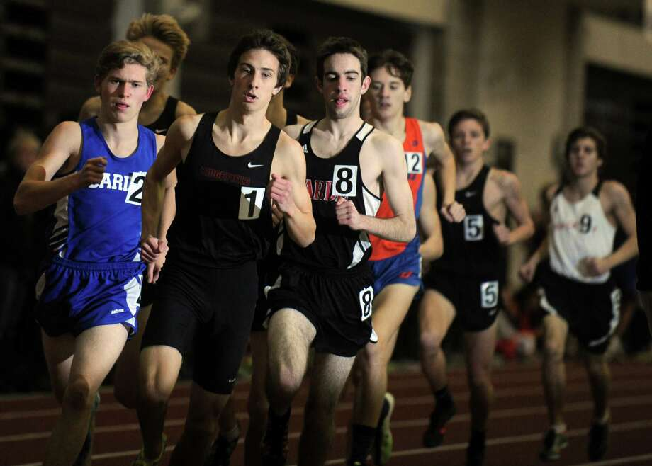 Ridgefield's Will Bordash leads the pack during the 1600 meter run during the FCIAC Indoor Track Championships Wednesday, Jan. 29, 2014, at the Floyd Little Athletic Center in New Haven, Conn. Photo: Autumn Driscoll / Connecticut Post