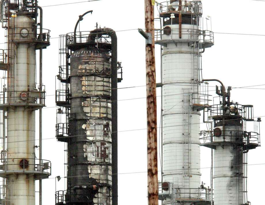 A charred heat exchanger offers evidence of the intense fire at Tesoro's refinery in Anacortes, Wash., after the explosion that killed seven workers in April 2010. Photo: KEN LAMBERT, Staff Photographer / Digital Image