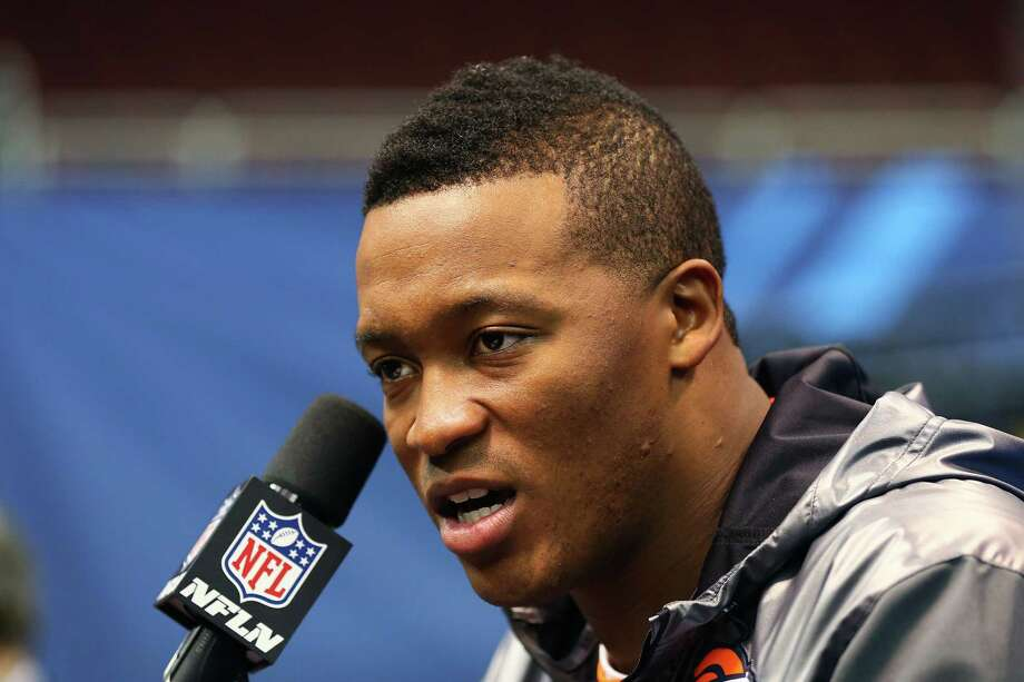NEWARK, NJ - JANUARY 28:  Wide receiver Demaryius Thomas #88 of the Denver Broncos speaks to the media during Super Bowl XLVIII Media Day at the Prudential Center on January 28, 2014 in Newark, New Jersey.  Super Bowl XLVIII will be played between the Seattle Seahawks and the Denver Broncos on February 2.  (Photo by Elsa/Getty Images) ORG XMIT: 465298017 Photo: Elsa / 2014 Getty Images