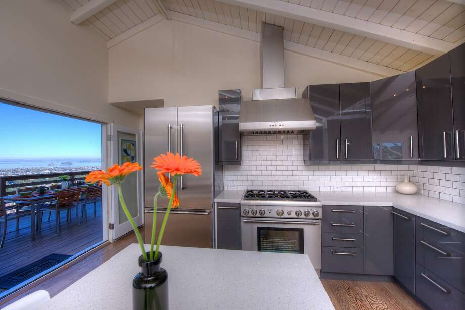 An area for al fresco dining sits off the kitchen. Photo: Matt McCourtney/McCourtney Photo