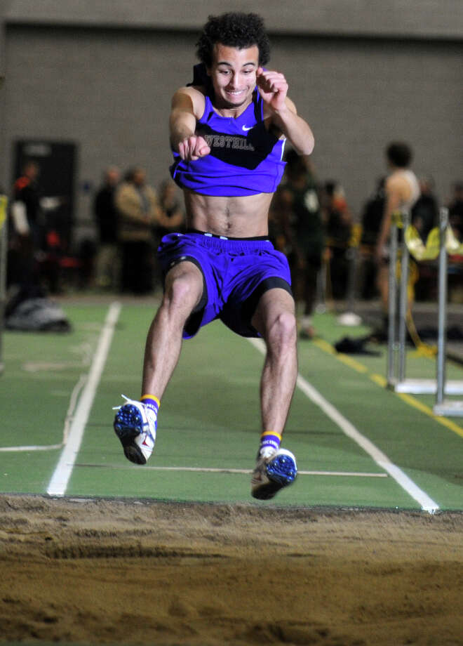 Westhill's Daniel Sanchez competes in the long jump event during the FCIAC Indoor Track Championships Wednesday, Jan. 29, 2014, at the Floyd Little Athletic Center in New Haven, Conn. Photo: Autumn Driscoll / Connecticut Post