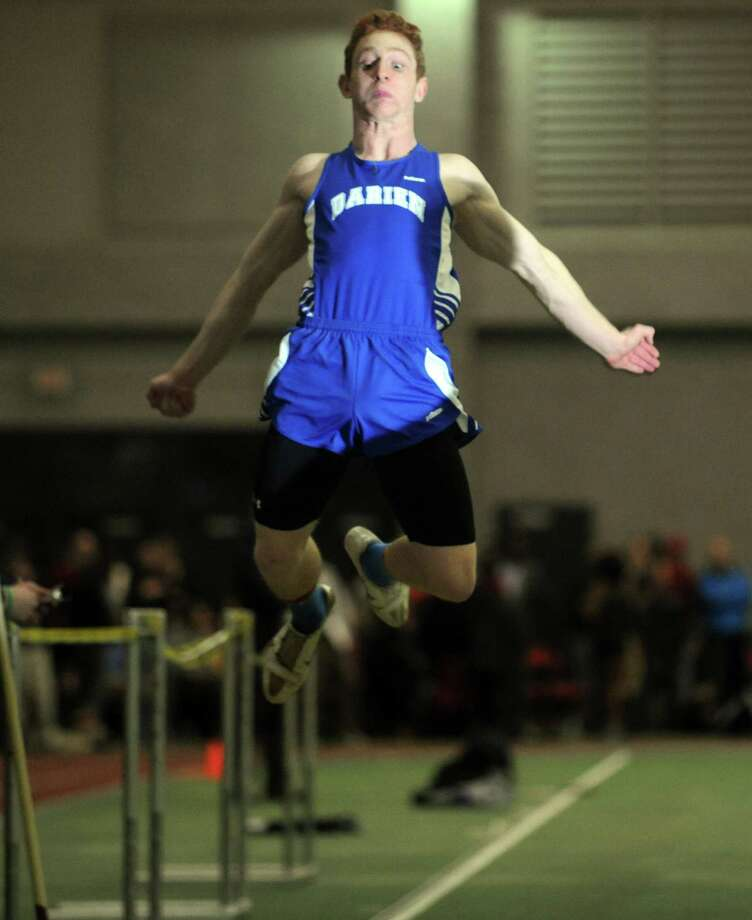 Darien's Nicholas Lombardo competes in the long jump event during the FCIAC Indoor Track Championships Wednesday, Jan. 29, 2014, at the Floyd Little Athletic Center in New Haven, Conn. Photo: Autumn Driscoll / Connecticut Post