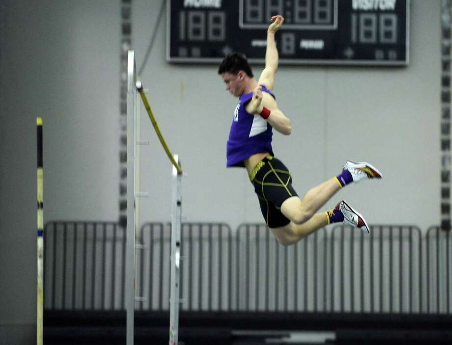 Westhill's Chris Rough competes in the pole vault event during the FCIAC Indoor Track Championships Wednesday, Jan. 29, 2014, at the Floyd Little Athletic Center in New Haven, Conn. Rough was the FCIAC boys pole vault champion at 14 feet. Photo: Autumn Driscoll / Connecticut Post