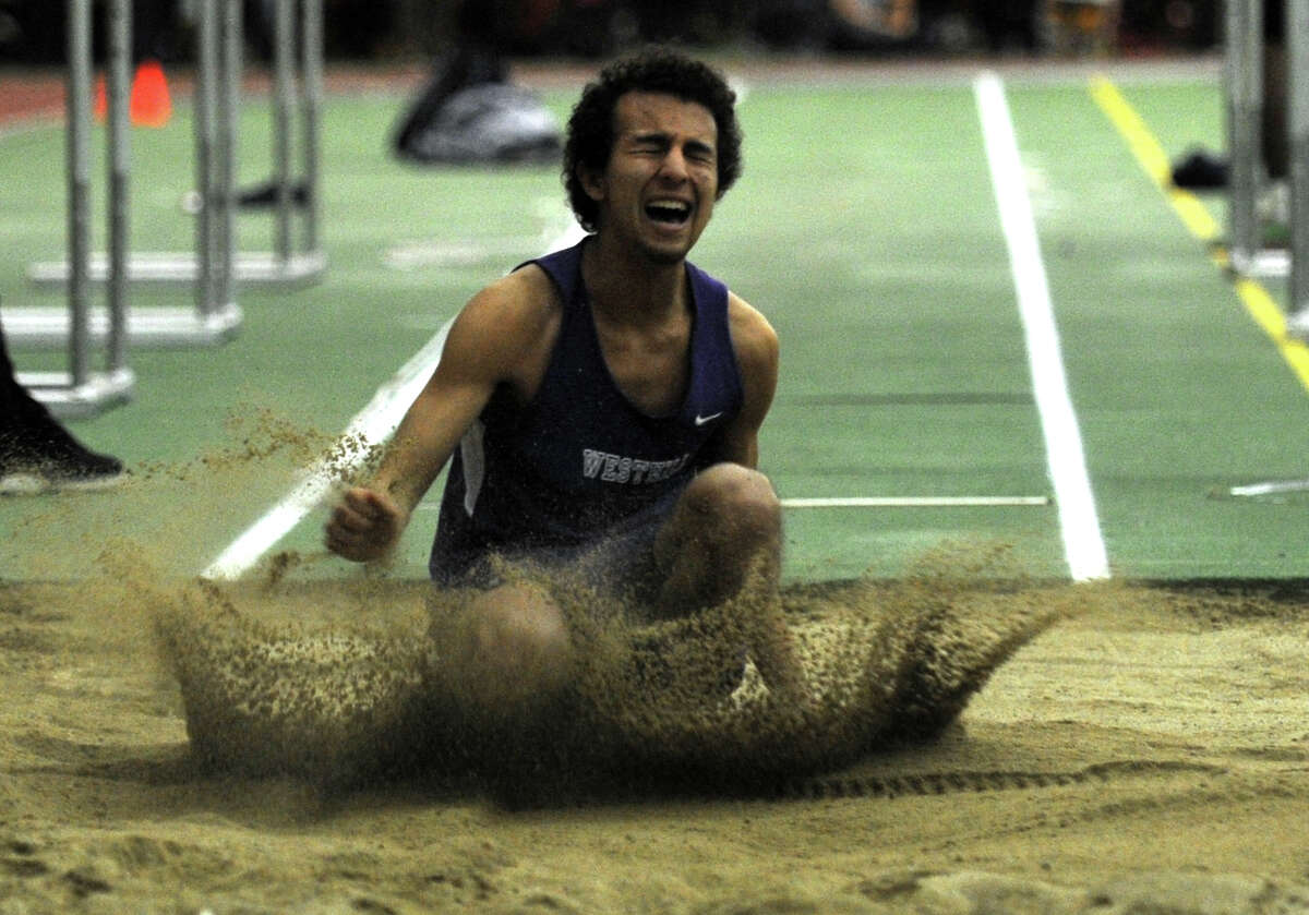 Westhill's Daniel Sanchez competes in the long jump event during the FCIAC Indoor Track Championships Wednesday, Jan. 29, 2014, at the Floyd Little Athletic Center in New Haven, Conn.