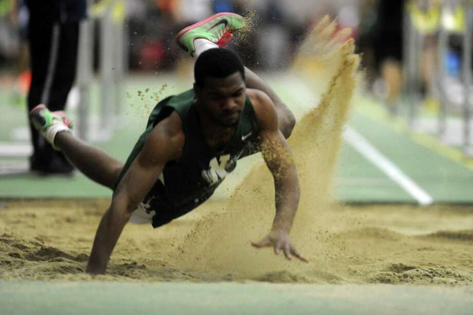 Norwalk's Lester Harris competes in the long jump event during the FCIAC Indoor Track Championships Wednesday, Jan. 29, 2014, at the Floyd Little Athletic Center in New Haven, Conn. Photo: Autumn Driscoll / Connecticut Post