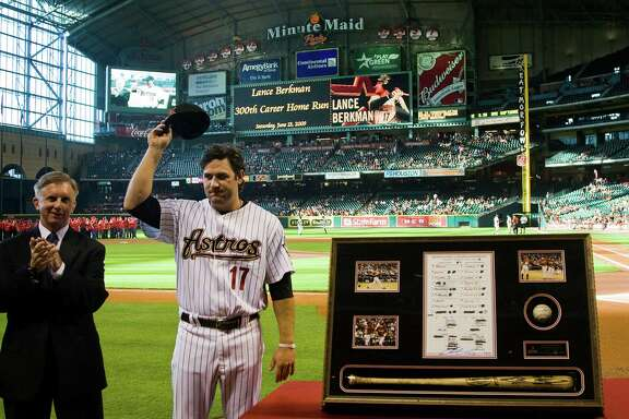 Lance Berkman acknowledges the crowd at Minute Maid Park in 2009 while being recognized for hitting his 300th career home run in a game at Arizona.