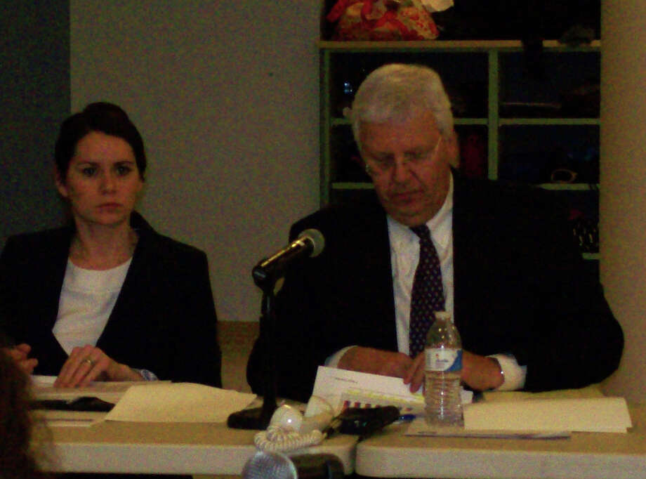 Emily Swift and Robert Pernicka of The Segal Group, the Board of Education's insurance consultant, attending the special meeting of the board Wednesday at Staples High School. Photo: Anne M. Amato / Westport News