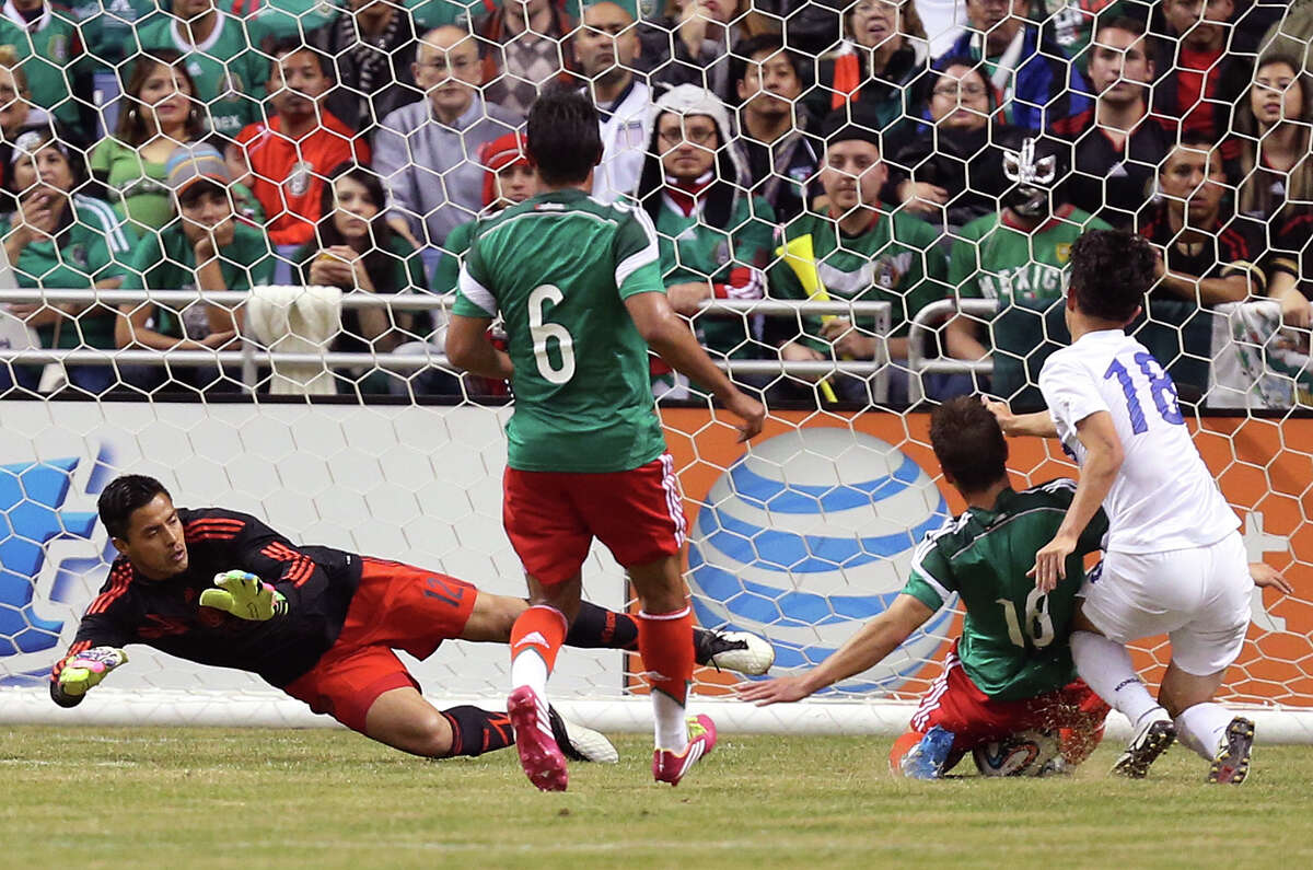 Mexico National Team defender Isaac Brizuela, (18), stops a scoring attempt by South Korea Lee Seung-Ki during the second half at the Alamodome, Wednesday, Jan. 29, 2014. Mexico beat Korea, 4-0. Also in on the play is Mexico's goalkeeper Alfredo Talaveras, left, and Juan Carlos Valenzuela, (6).