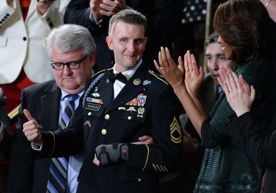 U.S. Army Ranger Cory Remsburg, who was wounded in Afghanistan, gives the thumbs-up as President Barack Obama speaks about him in his State of the Union address. Photo: Jewel Samad / AFP / Getty Images / AFP