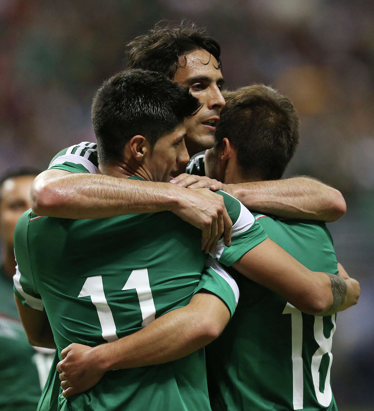 Mexico National Team Aldo de Nigris, center, joins teammates Alan Pulido, left, and Isaac Brizuela after Pulido scored in the second half against South Korea at the Alamodome, Wednesday, Jan. 29, 2014. Mexico beat Korea, 4-0.