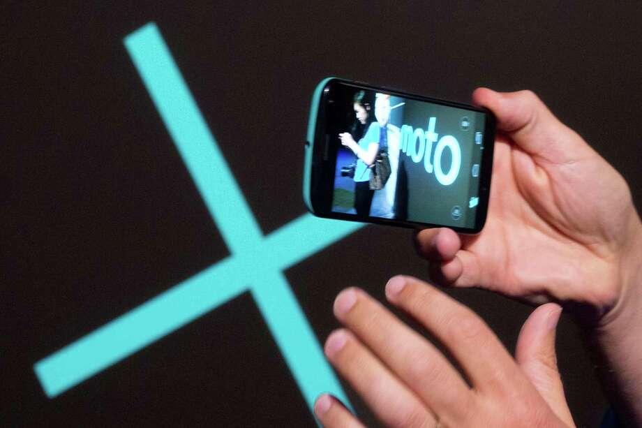 Video from a Motorola Moto X smartphone is displayed. Google is selling Motorola Mobility to Lenovo. Photo: MARK LENNIHAN, STF / AP