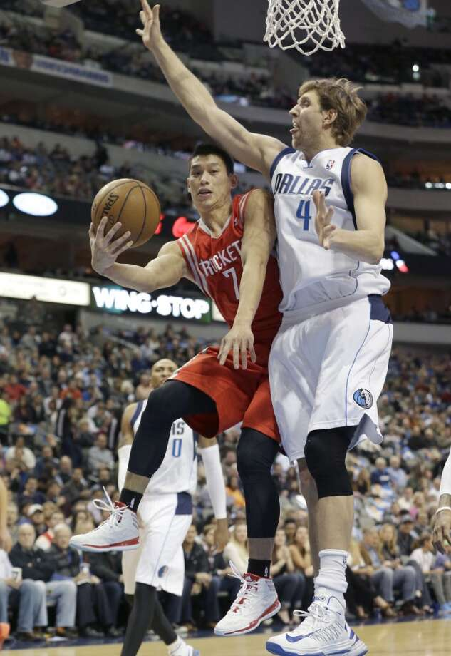 Houston Rockets point guard Jeremy Lin (7) shoots agains Dallas Mavericks power forward Dirk Nowitzki (41) of Germany during the first half of an NBA basketball game Wednesday, Jan. 29, 2014, in Dallas.  (AP Photo/LM Otero) Photo: LM Otero, Associated Press