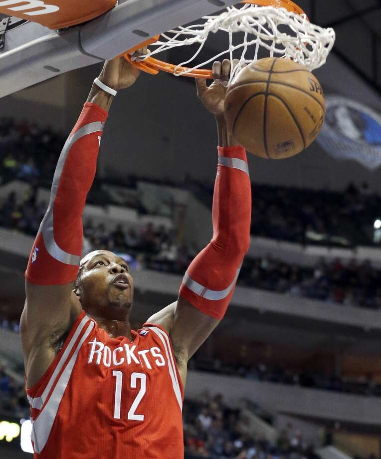 Rockets center Dwight Howard dunks. Photo: LM Otero, Associated Press