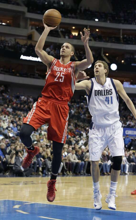 Rockets small forward Chandler Parsons (25) drives past Mavericks power forward Dirk Nowitzki. Photo: LM Otero, Associated Press